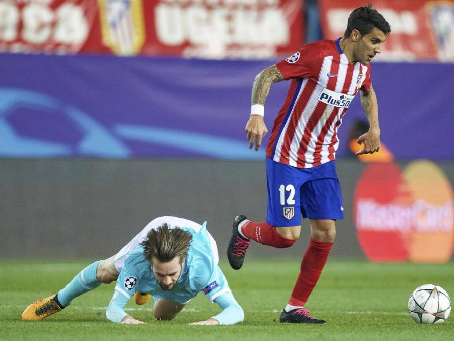 L R Davy Propper of PSV Augusto Fernandez of Club Atletico de Madrid during the UEFA Champions Le